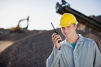 Construction worker talking into walkie-talkie (thumbnail)