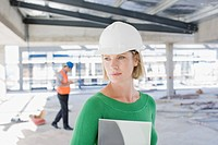 Woman in hard_hat on construction site