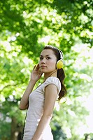 Young Japanese Woman Listening Music