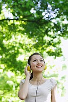 Woman Listening Music on Headphones