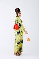 Young Woman in Kimono Holding Balloon