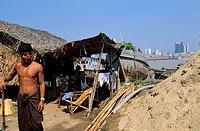 Myanmar Burma, Rangoon Division, whole families live in precarious homes on the Southern bank of Rangoon