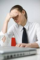 Business Woman Tired at laptop