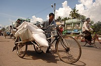 Man transporting a load with his bicycle