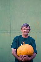 portrait of farmer holding pumpkin