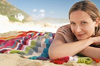 Woman lying on beach portrait