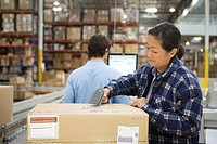 Woman and man working in distribution warehouse
