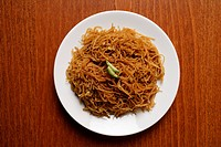 Chinese noodles on plate.