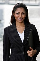 woman wearing business suit, holding folder