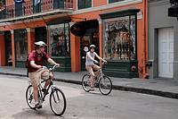 Tourists riding in bycicle, Royal Street, French Quarter, New Orleans, Louisiana, U.S.A., North America