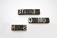 WEBSITE COMING SOON written backwards in metal letterpress letters