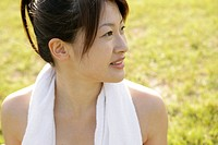 A side view of a woman with a towel around her neck