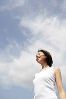 A woman feeling the freshness of the cool air under the sky