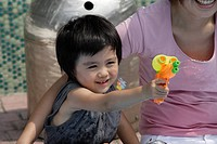 A boy playing with water pistol