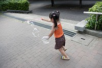 A girl playing bubbles