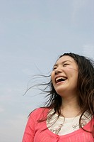 A young woman is seen under the sky as she laughs her way to glory (thumbnail)