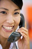 A portrait of a woman conversing on the telephone (thumbnail)