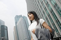 A woman standing amidst a commercial area (thumbnail)