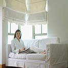 Portrait of a businesswoman relaxing on a couch (thumbnail)