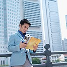 Low angle view of a businessman reading a magazine