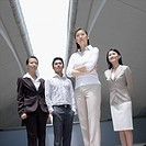 Low angle view of a businessman standing with three businesswomen