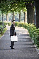 Businessman is seen walking with his briefcase