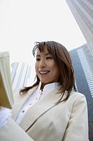 Businesswoman reading a book, portrait
