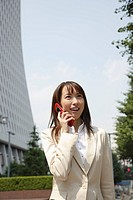 Businesswoman conversing on a cellphone, portrait