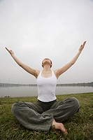 Front view of a young woman in lotus position (thumbnail)