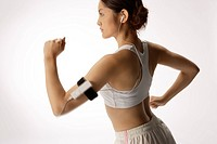 Close-up of a young woman exercising (thumbnail)