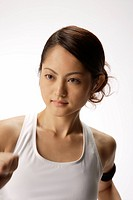 Close_up of a young woman exercising
