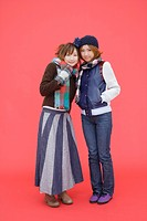 Portrait of two teenage girls in winter clothing