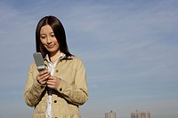 View of a young woman using cellphone