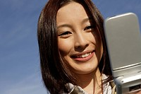 Close_up of a young woman using cellphone