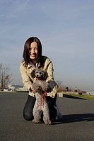 Portrait of a young woman with her pet dog (thumbnail)