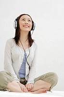 View of a young woman using a headphone (thumbnail)