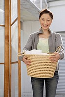 Portrait of a young woman holding a basket