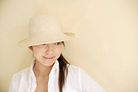 A young woman wearing hat