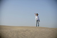 Young woman standing alone in desert