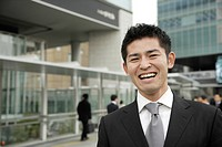 Close_up of a smiling businessman