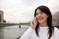Close-up of a young woman using mobile phone (thumbnail)