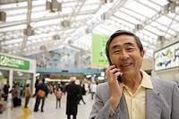 Close_up of a senior man using mobile phone