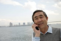 Portrait of a businessman using cellphone