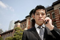 Portrait of a young man using mobile phone