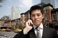 Portrait of a young businessman using a mobile phone