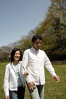 A young couple walking in garden (thumbnail)