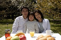 Portrait of a family sitting by breakfast table (thumbnail)
