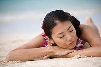 A young woman sleeping at beach