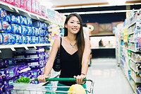A young woman shopping in supermarket