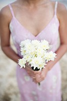 A woman holding bouquet of flowers